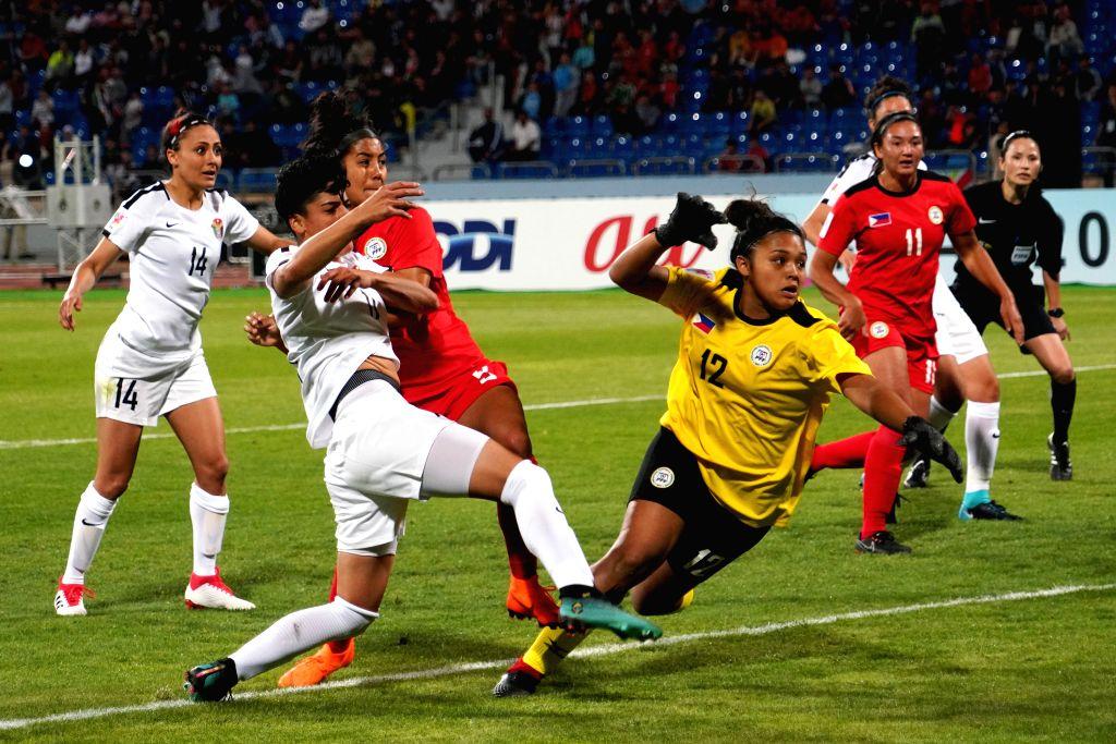 AMMAN, April 7, 2018 - Maysa Ziad Jbarah (2nd L) of Jordan shoots during the group A match between Jordan and Philippines at the 2018 AFC Women's Asian Cup, in Amman, Jordan, April 6, 2018.