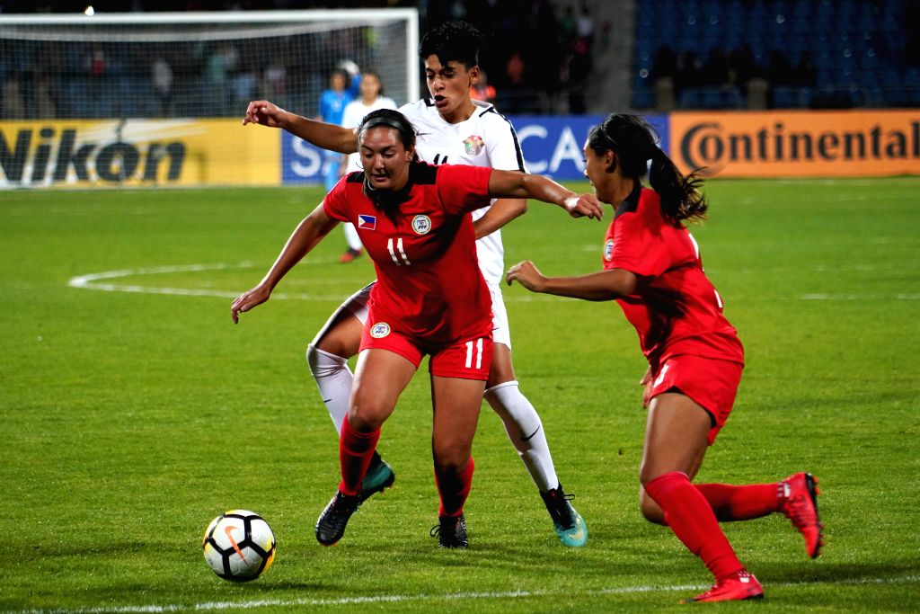 AMMAN, April 7, 2018 - Ryley Bugay (front L) of Philippines breaks through during the group A match between Jordan and Philippines at the 2018 AFC Women's Asian Cup, in Amman, Jordan, April 6, 2018.