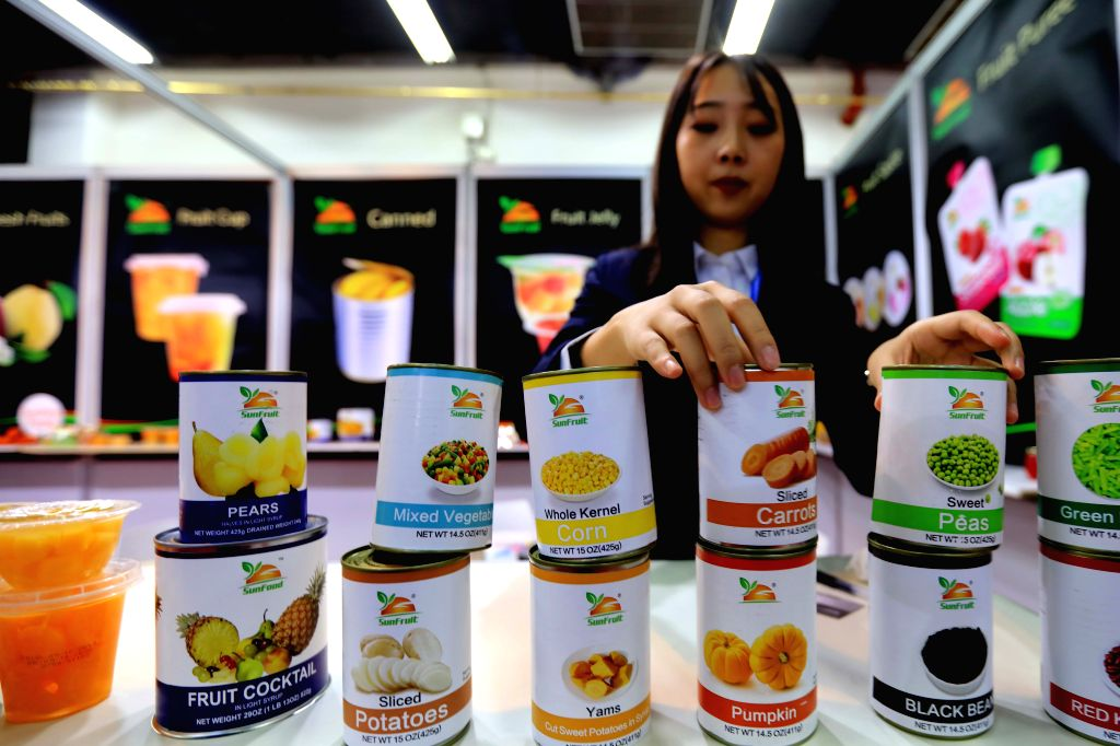AMMAN, Dec. 12, 2019 - A Chinese exhibitor arranges the products at the site of the 16th China Trade Fair in Amman, Jordan, Dec. 11, 2019. The 16th China Trade Fair kicked off in Amman on Tuesday, ...
