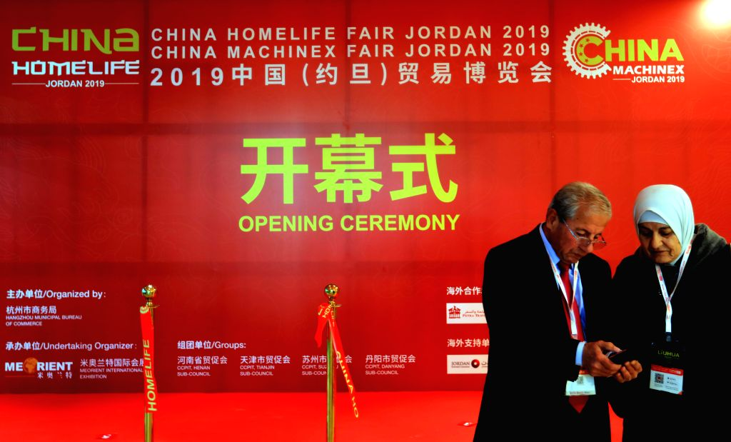 AMMAN, Dec. 12, 2019 - Visitors are seen at the site of the 16th China Trade Fair in Amman, Jordan, Dec. 11, 2019. The 16th China Trade Fair kicked off in Amman on Tuesday, displaying various Chinese ...