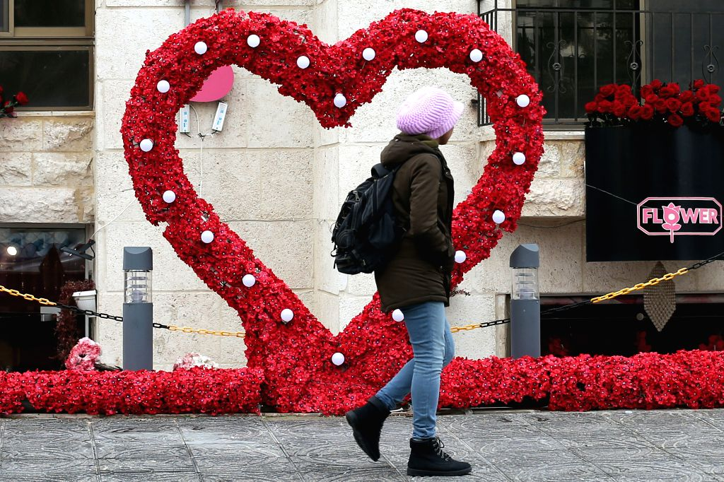 AMMAN, Feb. 14, 2019 - A Jordanian passes by decorations of roses for the Valentine's Day in front of a flower shop in Amman, Jordan, Feb. 14, 2019.
