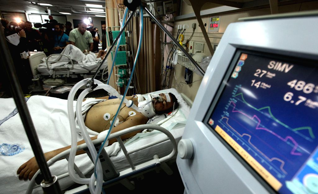 An injured Palestinian man, due to the ongoing Israeli military operation against Gaza Strip, receives treatment at Al Hussein Medical center in Amman, Jordan, on ...