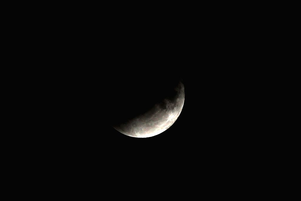 AMMAN, July 16, 2019 - A partial lunar eclipse is seen in Amman, Jordan, on July 16, 2019.