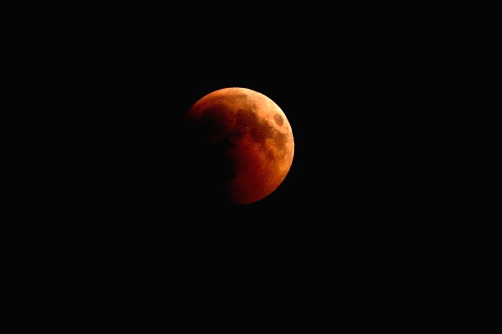 AMMAN, July 27, 2018 - The moon is seen during a lunar eclipse in Amman, Jordan, July 27, 2018.