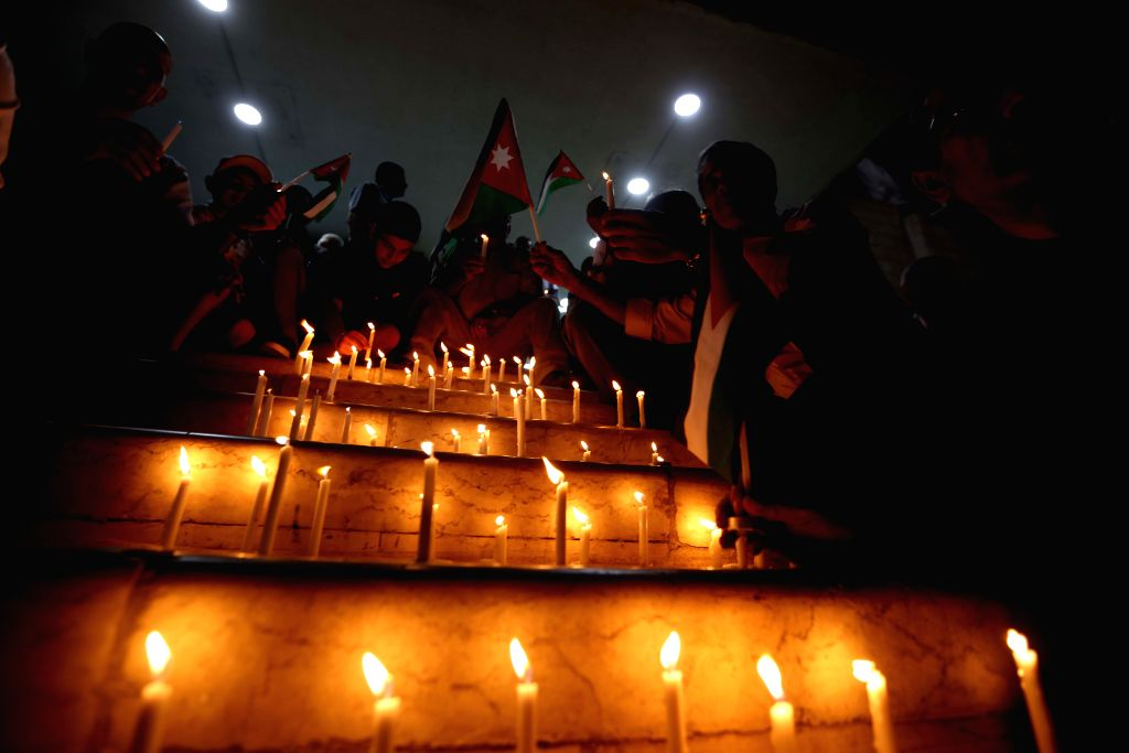 AMMAN, June 22, 2016 - People light candles in a vigil for the victims of a terrorist attack at Jordan's border with Syria, in Amman June 21, 2016. A suicide attacker detonated a car bomb on Tuesday ...