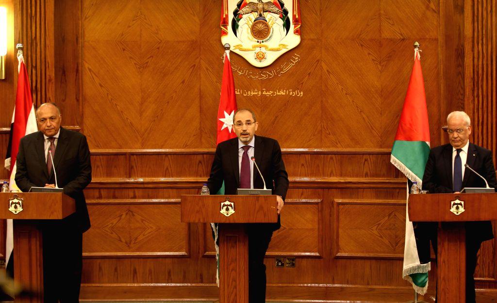 AMMAN, May 14, 2017 - Jordan's Minister of Foreign Affairs Ayman Safadi (C), Egyptian Foreign Minister Sameh Shukri (L) and Saeb Erekat, secretary general of the Palestine Liberation Organization, ... - Sameh Shukri