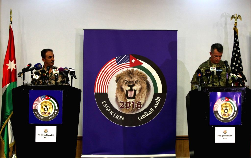 "AMMAN, May 15, 2016 - U.S. Major General Ralph H. Groover (R) and Jordanian Brigadier General Fahed Al-Damen attend a press conference on the 2016 ""Eager Lion"" joint military exercise in ..."