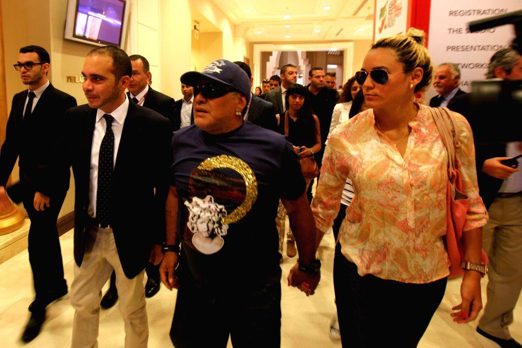 FIFA presidential candidate, Jordan's Prince Ali bin al-Hussein (front L), walks alongside Argentina's legendary ex-footballer Diego Maradona (C) and his partner Rocio ...