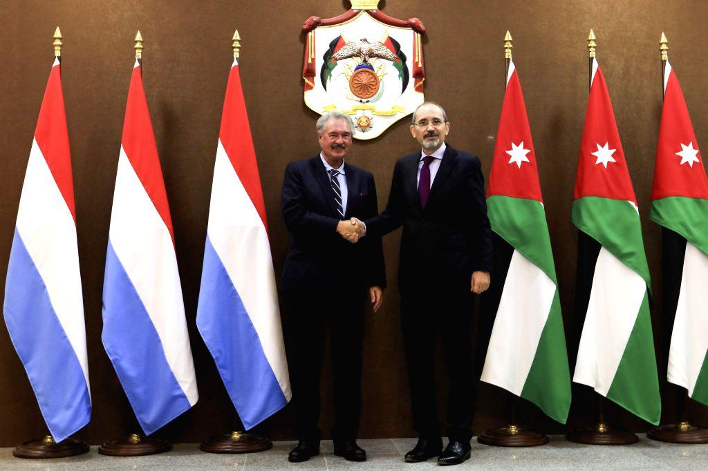 AMMAN, Sept. 12, 2019 - Luxembourg Foreign Minister Jean Asselborn (L) shakes hands with his Jordanian counterpart Ayman Safadi in Amman, Jordan, Sept. 12, 2019. - Jean Asselborn