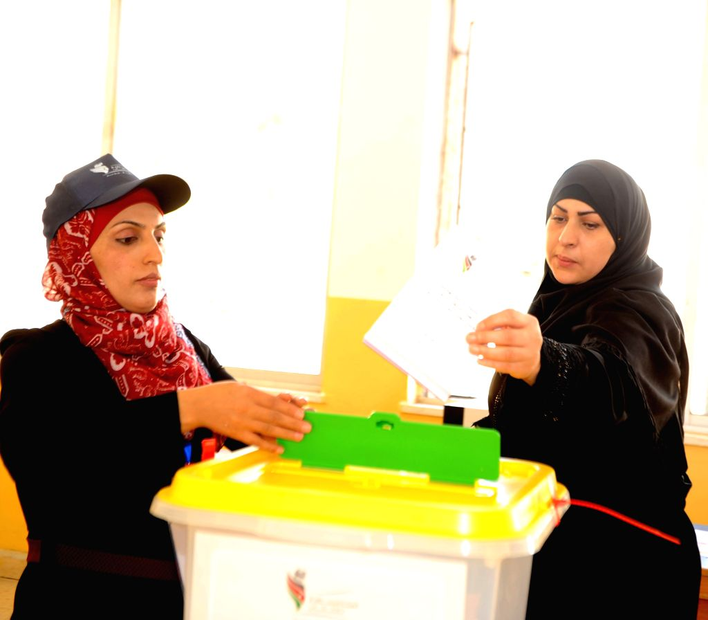 AMMAN, Sept. 20, 2016 - A Jordanian woman casts her vote at a polling station in Amman, Jordan, Sept. 20, 2016. More than 4 million eligible voters in Jordan went to polling stations on Tuesday to ...