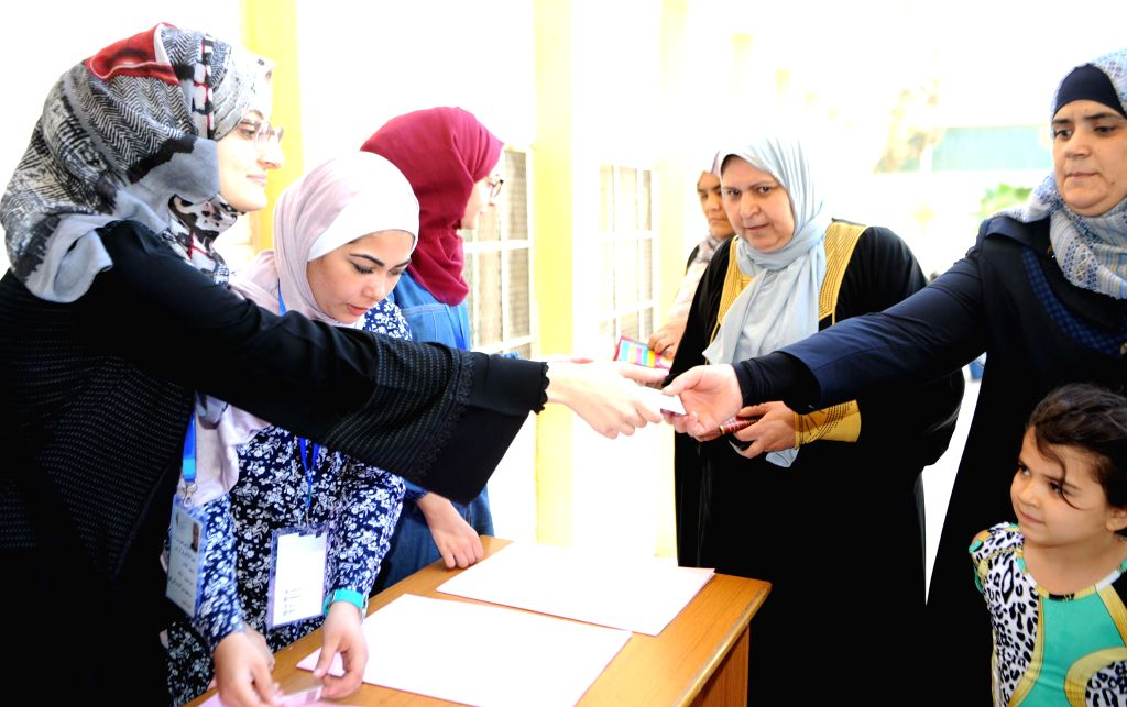 AMMAN, Sept. 20, 2016 - Jordanian women come to cast their votes at a polling station in Amman, Jordan, Sept. 20, 2016. More than 4 million eligible voters in Jordan went to polling stations on ...