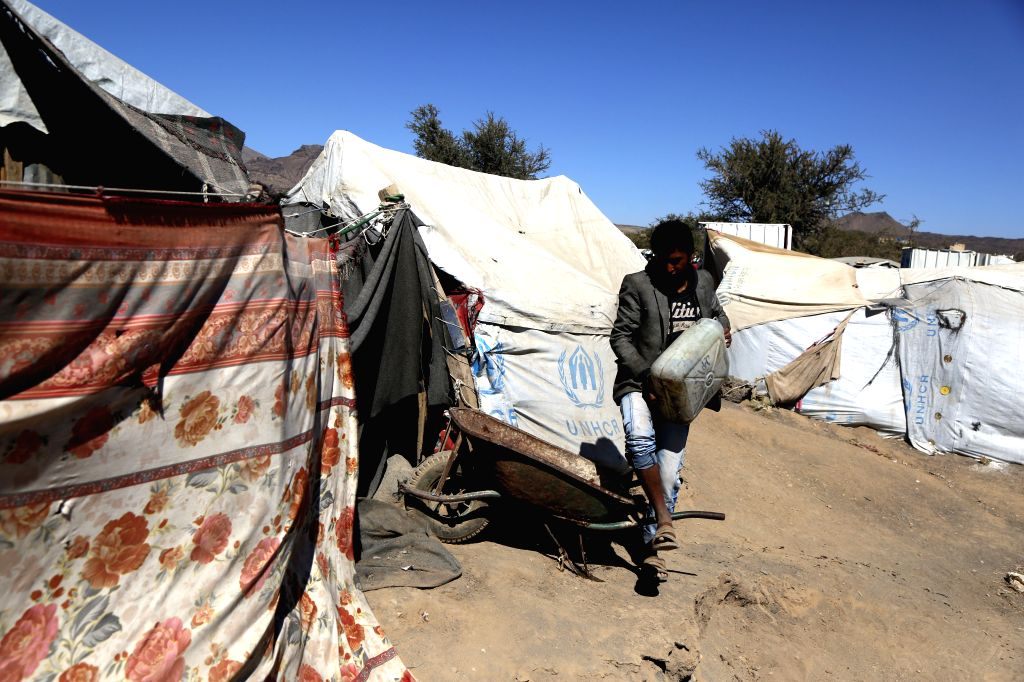 AMRAN, Jan. 22, 2019 - A man carries drinking water at Darawan displacement camp in Amran province, north of Sanaa, Yemen, on Jan. 21, 2019. The four-year war has killed more than 10,000 people, ...