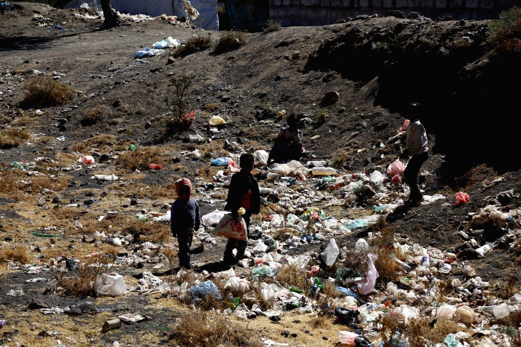 AMRAN, Jan. 22, 2019 - Children are seen among garbage at Darawan displacement camp in Amran province, north of Sanaa, Yemen, on Jan. 21, 2019. The four-year war has killed more than 10,000 people, ...