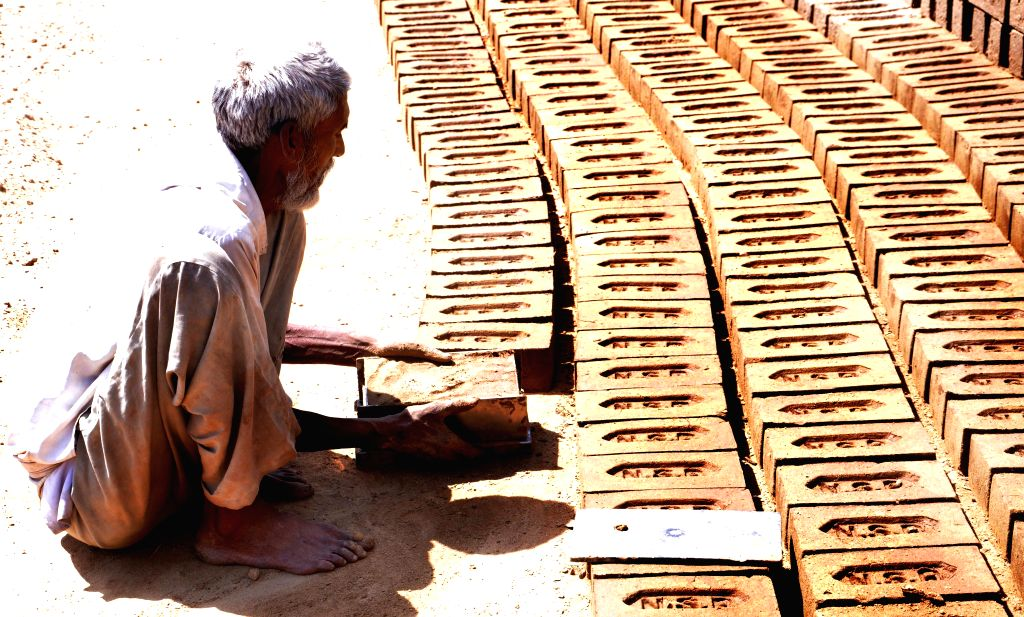 A labour busy working at a brick kiln on the outskirts of Amritsar on May 1, 2015. 1st May is celebrates as May Day throughout the world.