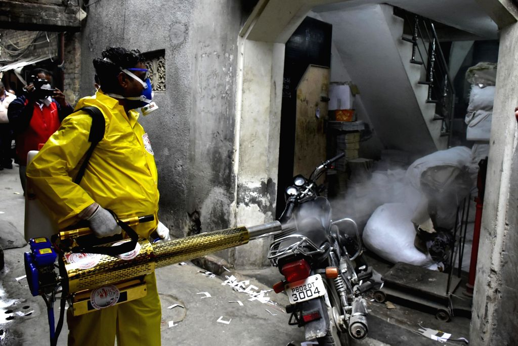 Amritsar: A municipal worker sprays disinfectants as a precautionary measure to contain COVID-19, in Amritsar on March 21, 2020. (Photo: IANS)