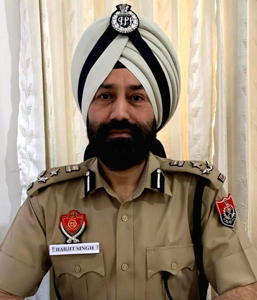 Amritsar: A Punjab police personnel wears the name of ASI Harjeet Singh on his badge, whose hand was chopped off in clashes between the police and the Nihang Sikhs in Patiala; as a gesture to honour him in Amritsar during the extended nationwide lock - Harjeet Singh