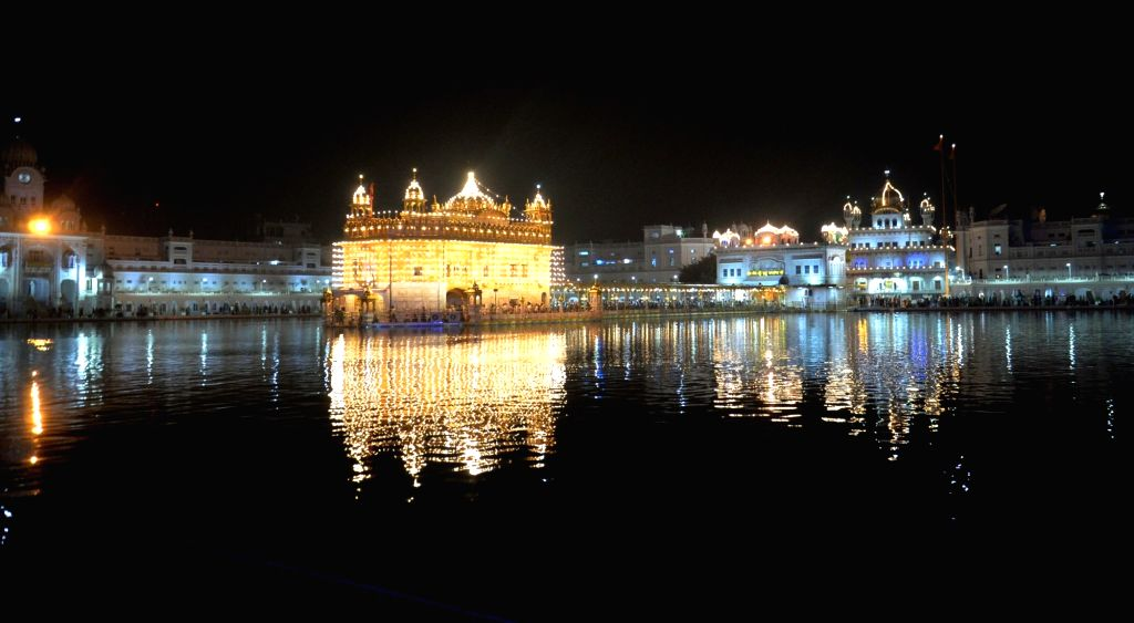 Amritsar: A view of beautifully lit Golden Temple on Diwali or Bandi Chhor Divas in Amritsar, on Nov 11, 2015. (Photo: IANS)