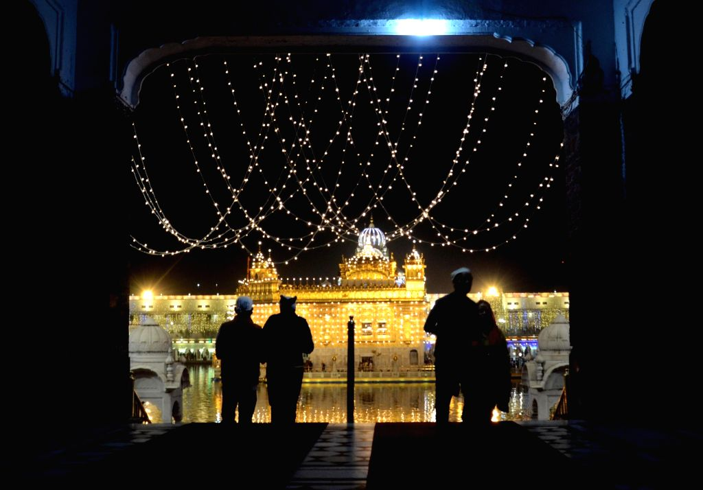 Amritsar: A view of the Illuminated Golden Temple on the eve of Diwali, in Amritsar on Nov 13, 2020. (Photo: IANS)
