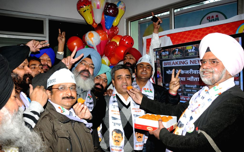 Aam Aadmi Party (AAP) workers celebrate party's performance in the recently concluded Delhi Assembly Polls in Amritsar, on Feb 10, 2015.