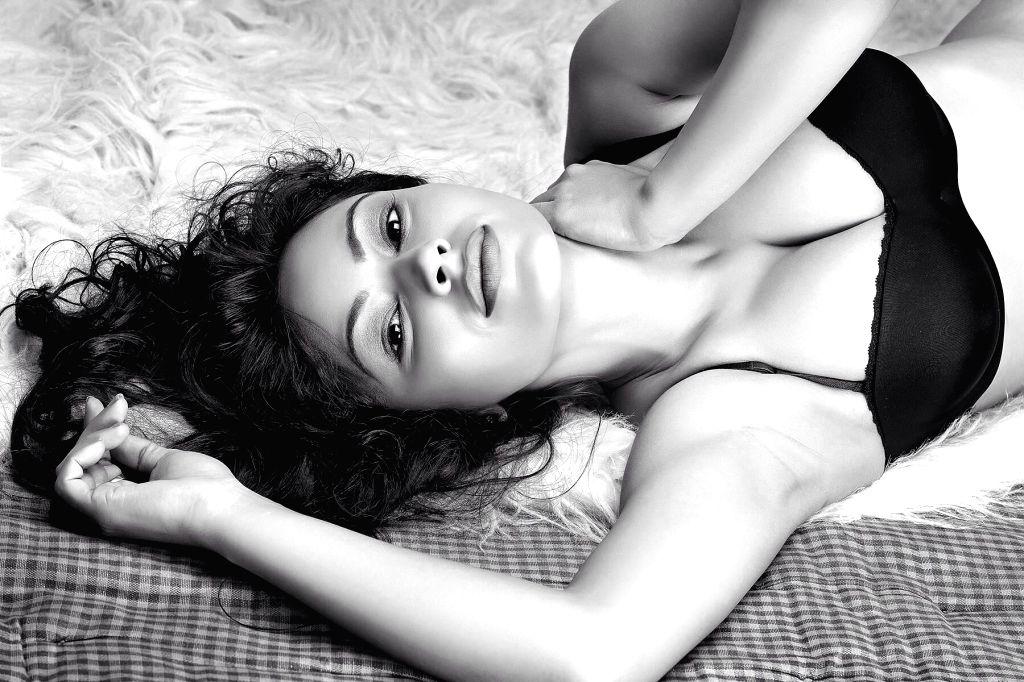 Actress and model Devshi Khanduri poses during a photoshoot.