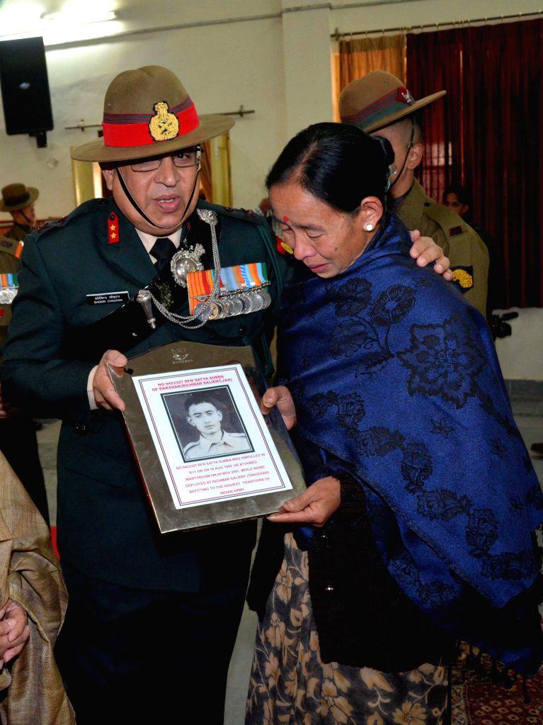 Additional Director General (public information) Major-General Shokin Chauhan presents a memento to the mother of slain Indian soldier Satya Subba the Golden Jubilee Sainik Sammelan at ... - Shokin Chauhan