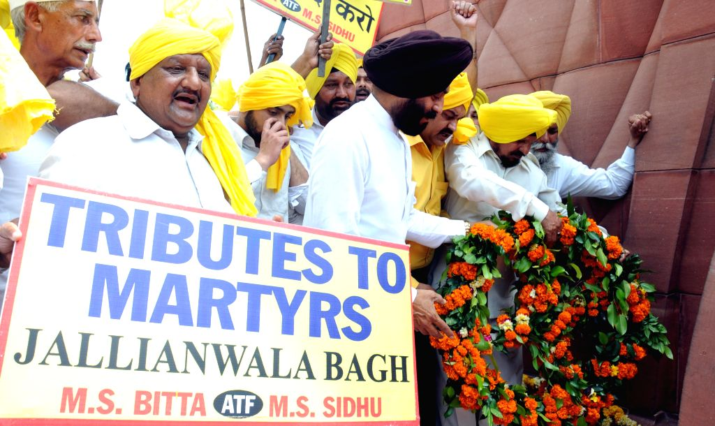 All-India Anti-Terrorist Front chairman MS Bitta and others pay tribute to the martyrs  on the eve of the  anniversary of the Jallianwala Bagh massacre in Amritsar on April 12, 2015.