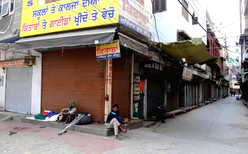 Amritsar: Amritsar observes complete shutdown after Punjab Chief Minister Amarinder Singh announced a full curfew in the state with no exemption even in daily needs and medical stores, in Amritsar on March 23, 2020. (Photo: IANS) - Amarinder Singh