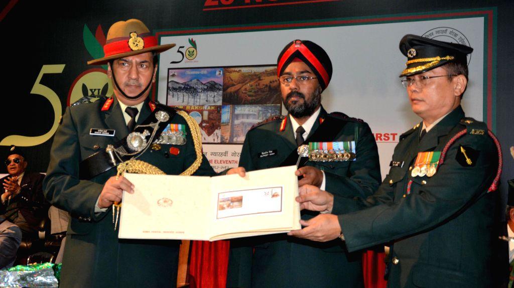 Army officers release a stamp on the Golden Jubilee Sainik Sammelan at Khasa near Amritsar on Nov 23, 2014.