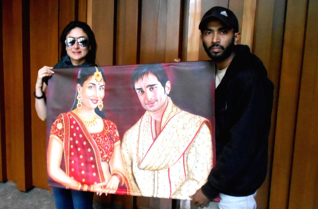 Artist Jagjot Singh Rubal presents a painting to actress Kareena Kapoor in Amritsar, on March 20, 2015.