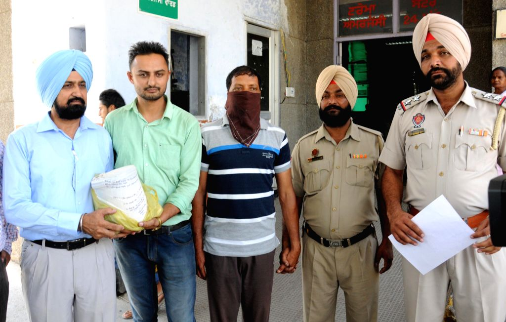 Babbar Khalsa activist Pyara Singh being taken for medical check-up after he was arrested in Amritsar on June 12, 2015. Police recovered two kg heroin from his possession. - Pyara Singh