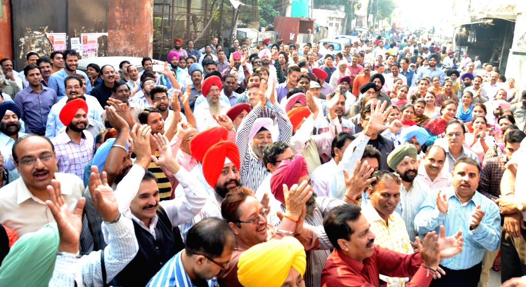Bank Employees demonstrate in front of bank during a day-long strike called to press for their demands, including pay revision in Amritsar, on Nov 12, 2014. Employees of 27 public sector ...