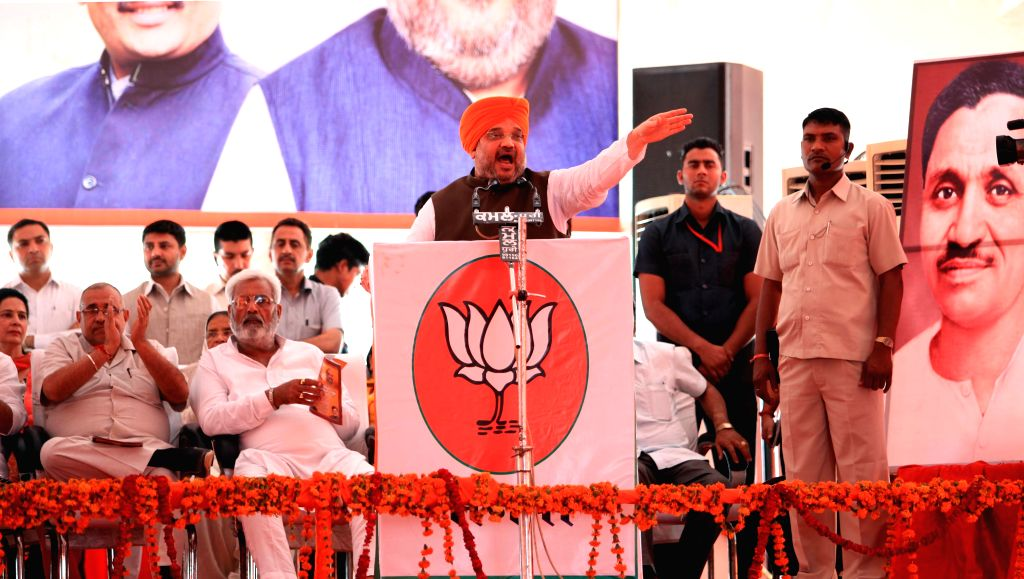 BJP chief Amit Shah addresses during First Active workers meet in Amritsar on May 2, 2015.