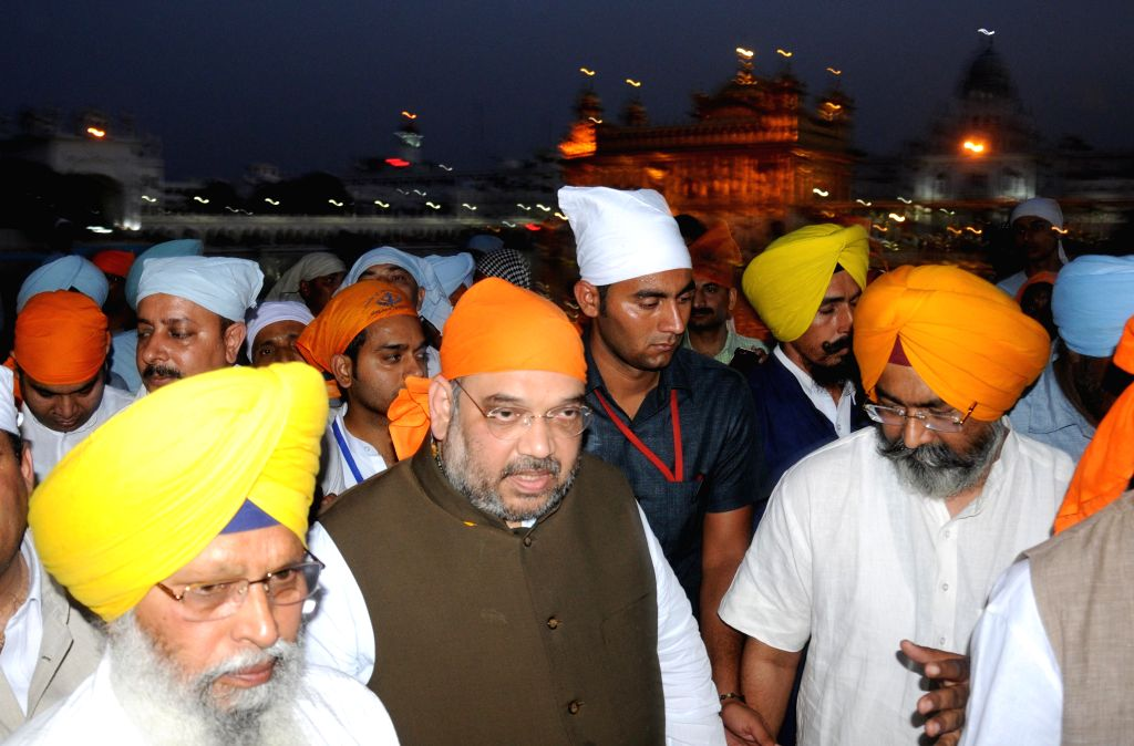 BJP chief Amit Shah pays obeisance at Golden Temple in Amritsar on May 2, 2015.