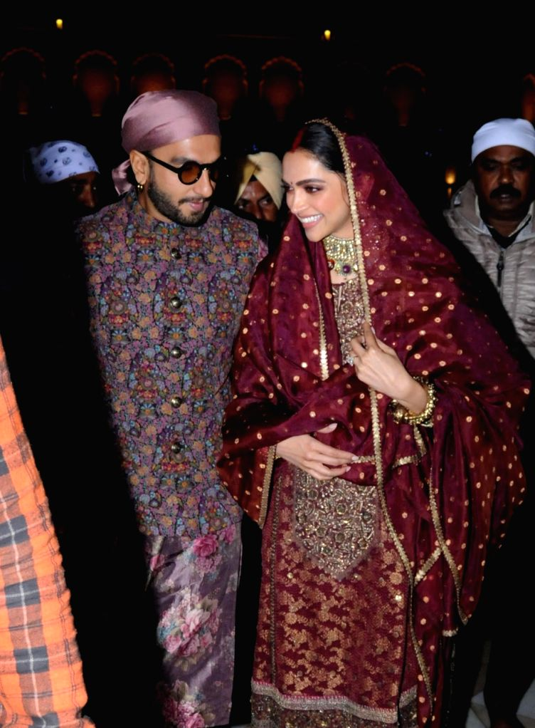 Amritsar: Bollywood actors Ranveer Singh and Deepika Padukone offer prayer at Golden Temple after their first wedding anniversary in Amritsar, on  Nov. 15, 2019. - Ranveer Singh and Deepika Padukone