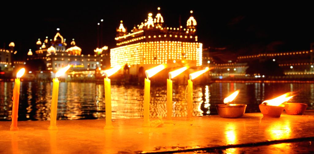 Candles light-up the Golden Temple on Baisakhi in Amritsar, on April 14, 2015.