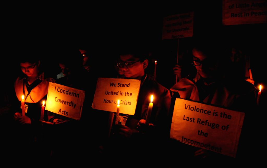 Children participate in a candle light vigil to protest against Tuesday's attack on the Army Public School in Peshawar, Pakistan, that claimed 104 lives mostly those of children, in ...