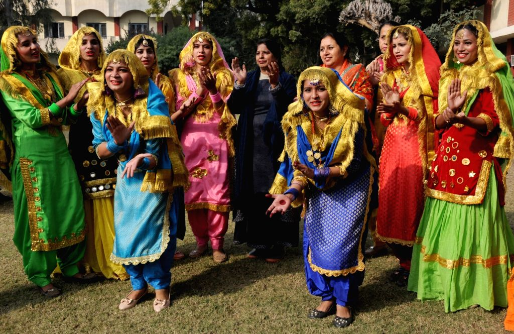 Amritsar: College students dressed up in traditional attires celebrate Lohri on the eve of the festival in Amritsar, on Jan 12, 2019. (Photo: IANS)