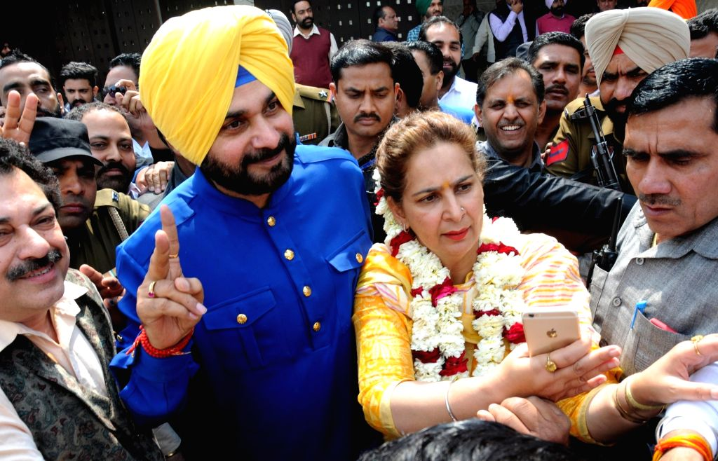 :Amritsar: Congress candidate from Amritsar East assembly constituency Navjot Singh Sidhu with his wife Navjot Kaur Sidhu celebrate as assembly election results being announced in Amritsar on March ...