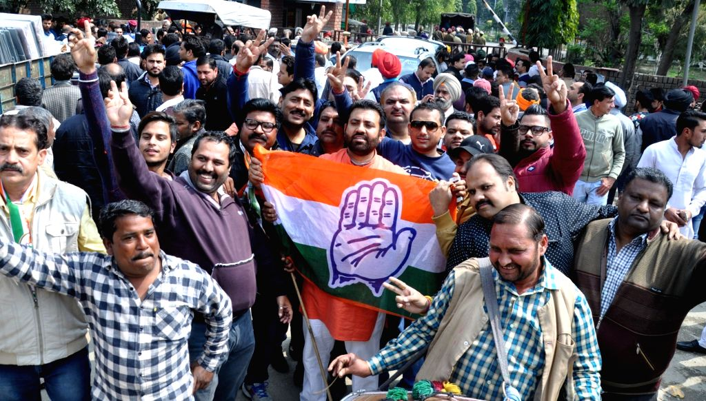 :Amritsar: Congress supporters celebrate party's victory in Punjab Assembly elections; in  Amritsar on March 11, 2017. (Photo: IANS).
