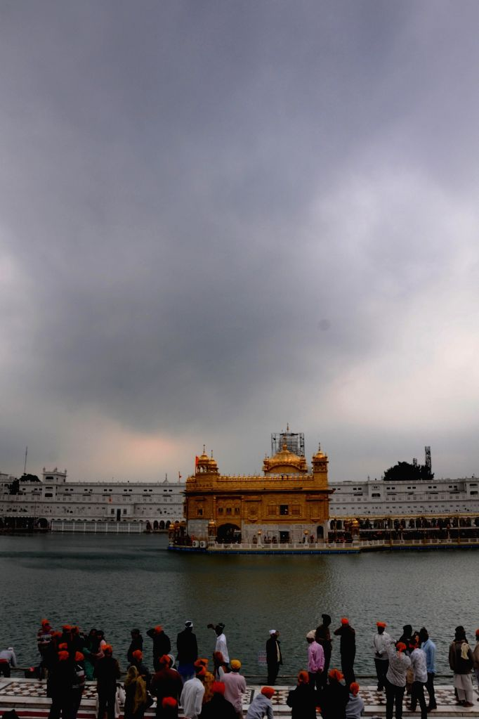 : Amritsar: Dark clouds hover over the Golden Temple in Amritsar on Feb 12, 2018. (Photo: IANS).