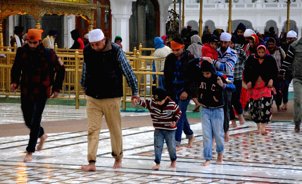 Devotees at the Golden Temple on a rainy day in Amritsar on Feb 20, 2015.