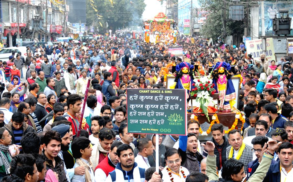 Devotees participate during the procession of Lord Jagannath Rath Yatra in Amritsar on Dec. 13, 2014.