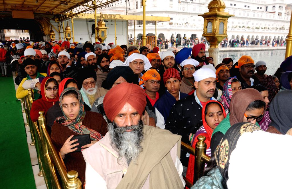 Devotees throng the Golden Temple on Makar Sankranti in Amritsar on Jan 14, 2015.