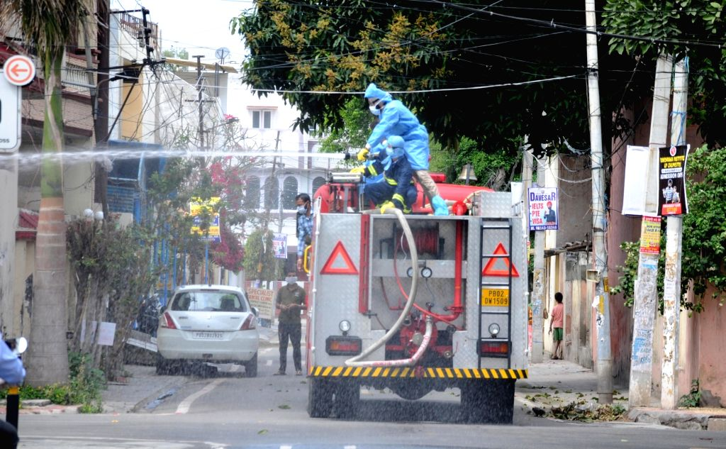 Amritsar: Disinfectants being sprayed across Amritsar to contain the spread of COVID-19 during the 21-day national lockdown, on March 25, 2020. (Photo: IANS)
