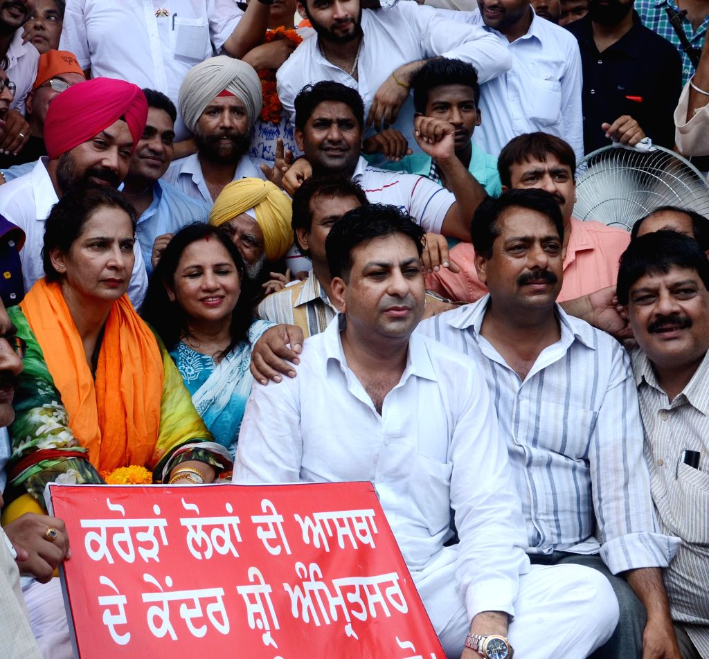 Amritsar (East) MLA and chief parliamentary secretary Navjot Kaur Sidhu of BJP stages a demonstration to press for the release of development funds for her constituency in Amritsar, on Aug ...