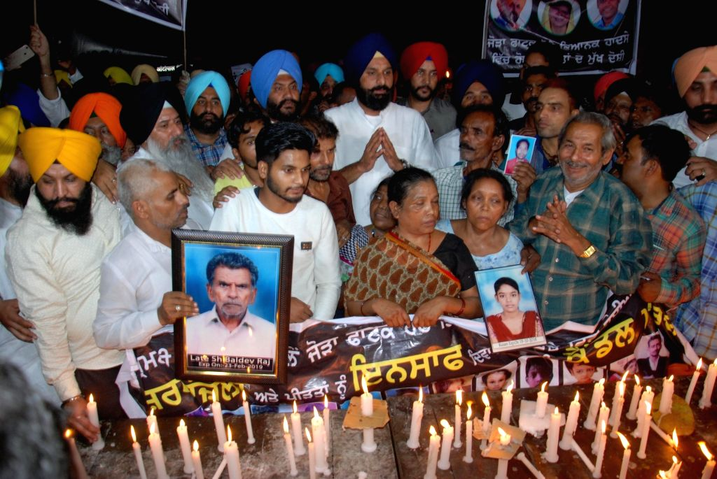 Amritsar: Family members of the victims of the Amritsar train tragedy where a local train crushed at least 60 people and left 72 injured while watching the burning of a Ravana effigy during Dusehra celebrations from a railway track; led by Shiromani  - Bikram Singh Majithia