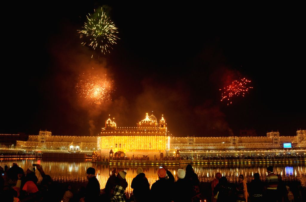 Fireworks light-up the sky above the Golden Temple on the 350th birth anniversary of Guru Gobind Singh in Amritsar, on Dec 28, 2014.