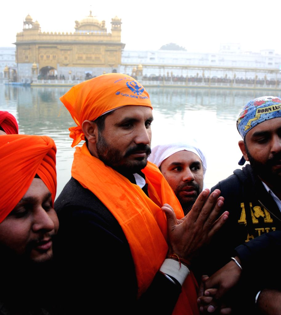 Indian Youth Congress (IYC) chief Amrinder Singh Raja Brar pays obeisance at the Golden Temple in Amritsar, on Jan 11, 2015.