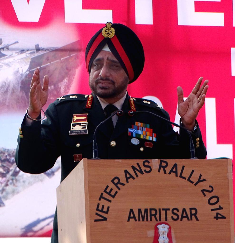 Lieutenant General KJ Singh addresses the war widows during the Veterans Rally at Khasa near Amritsar, on Dec 7, 2014.