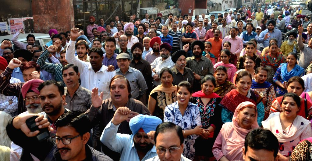 Main Branch of State Bank of India, Amritsar wears a deserted look as bank employees join a day-long strike called to press for their demands, including pay revision on Nov 12, 2014. ...